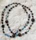 "BLACK CHUNKY - Double strand Czech glass with aurora borealis finish. Hand-chained on nickel. Available as a single strand. Silver-plated pewter toggle clasp.  19"" Hand-chained. The double is $188. Single $98."