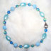 "ROBIN'S EGG -   Vintage blue moonglow lucite and cracle beads. 16.5"" Silver-plated pewter toggle clasp. $82"