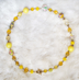 "YELLOW ROSES - Yellow and clear plastics and glass.  19"" Gold-plated pewter toggle clasp. $78"